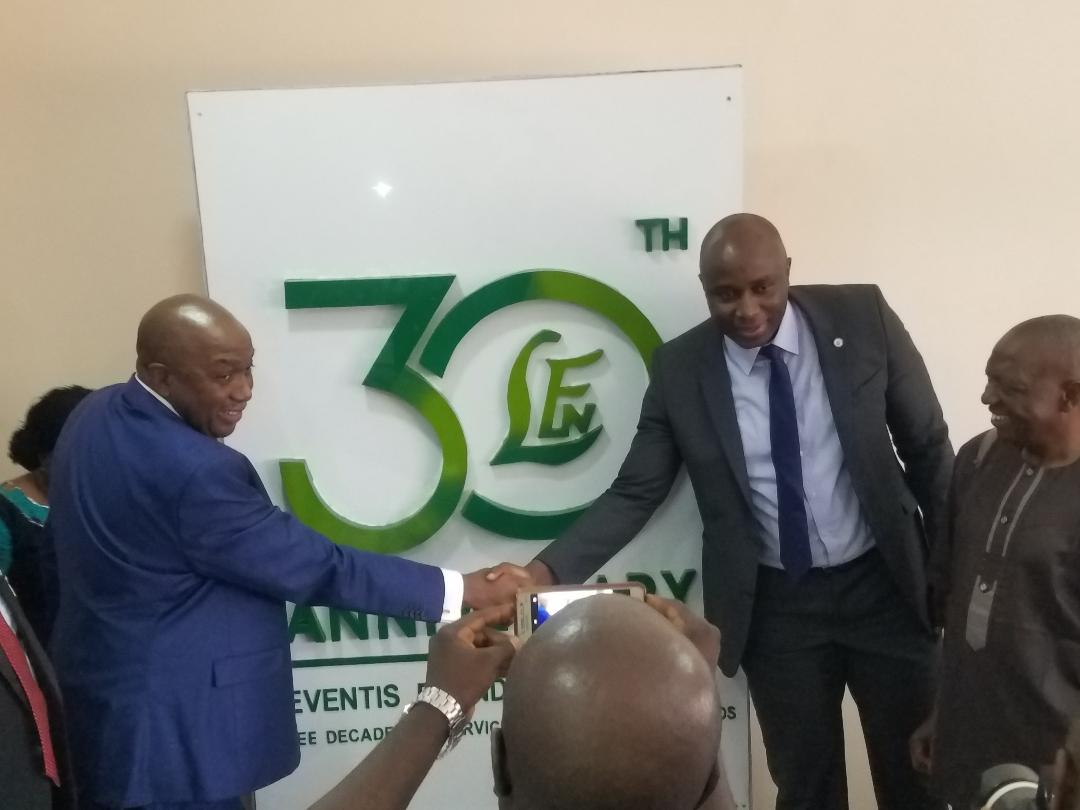 Chairman flanks ED at Unveiling of the Anniversary Logo